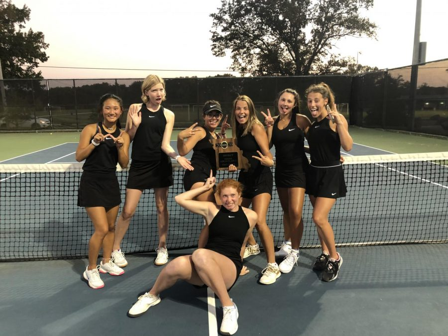 The tennis girls with their new plaque.