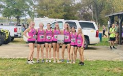 Farmington's Cross Country varsity girls taking the 1st place victory at the conference meet in Potosi Missouri on October 10, 2020.