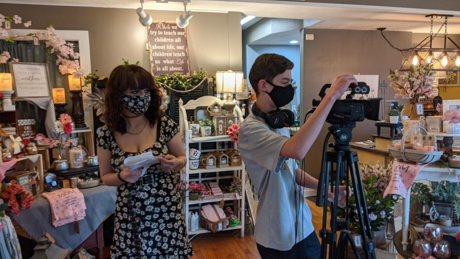 Linea Smith and Jace Denison shooting footage at the Copper Lantern in downtown Farmington.