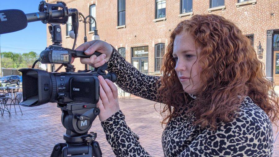 Addison Brenneke frames her shot of Ophelia in downtown Farmington.